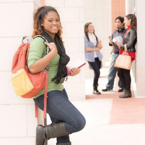 smiling-teenager-in-hallway